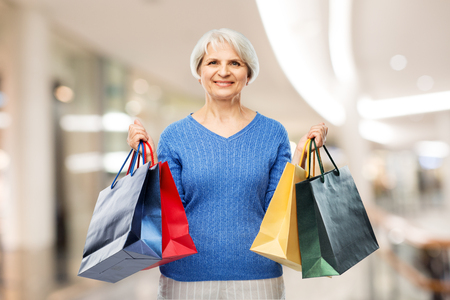 senior woman with shopping bags over mall Stok Fotoğraf