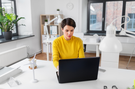businesswoman with laptop working at office