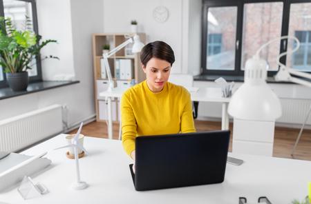 businesswoman with laptop working at office Standard-Bild - 124767089