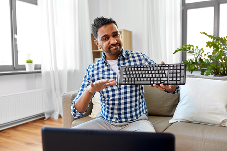 male blogger with keyboard videoblogging at home