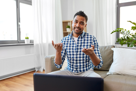 indian male blogger shrugging at home
