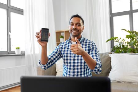 male blogger with smartphone videoblogging Banco de Imagens