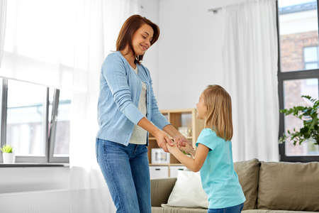 mother and daughter having fun at home Stock Photo
