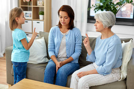 daughter, mother and grandmother arguing at home