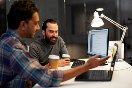 creative team drinking coffee at night office Stock Photo