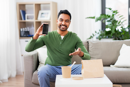 indian man using smartphone for food delivery Stock Photo