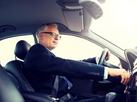 happy senior businessman starting car and driving Фото со стока