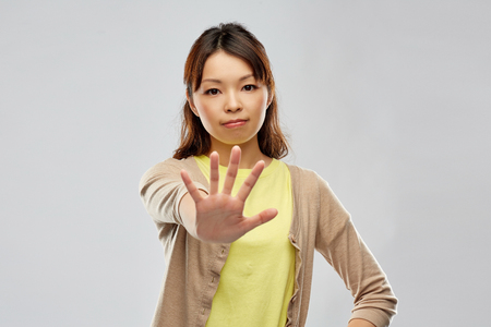 young asian woman showing stop gesture Stock Photo