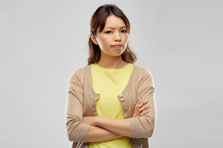displeased asian woman with crossed arms 스톡 콘텐츠