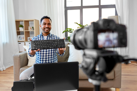 male blogger with keyboard videoblogging at home Banco de Imagens