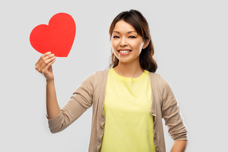 happy asian woman with red heart Stockfoto