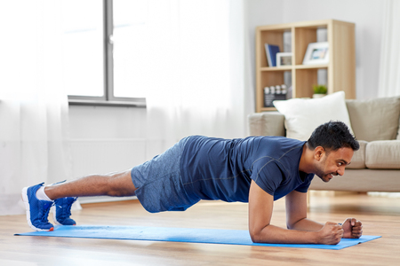 man doing plank exercise at home Standard-Bild