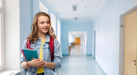 happy smiling teenage student girl with school bag