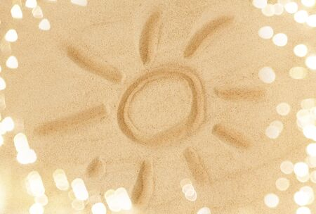 picture of sun in sand on summer beach
