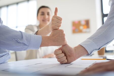 group of business team making thumbs up gesture Imagens