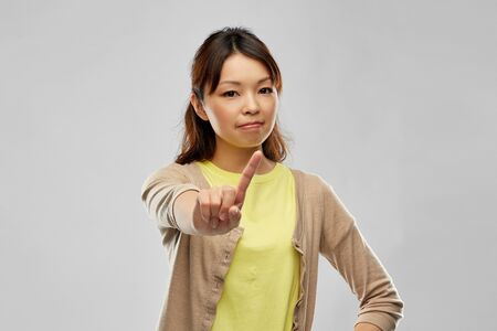 young asian woman threatening with finger Archivio Fotografico - 124633973