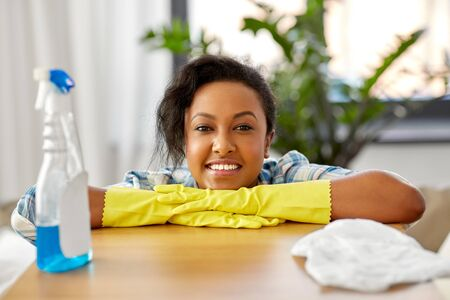 african american woman cleaning at home Stock Photo