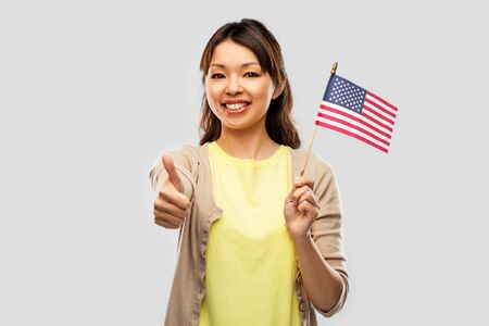 happy asian woman with american flag
