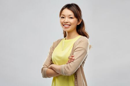 happy asian woman over grey background Stock Photo