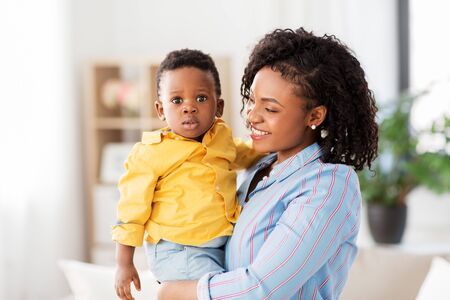 happy african american mother with baby at home