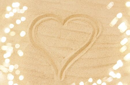 picture of heart in sand on summer beach