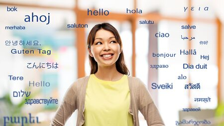 asian woman looking up over foreign languages