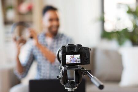 camera recording video blogger with headphones