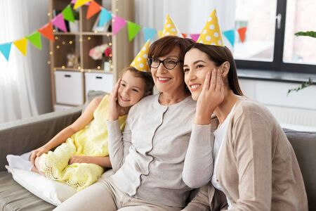 mother, daughter and grandmother at birthday party 스톡 콘텐츠