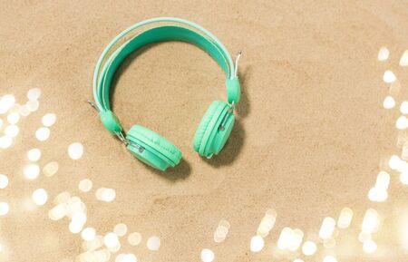 earphones on summer beach sand