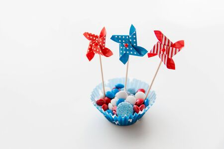 candies with pinwheel toys on independence day Stock Photo