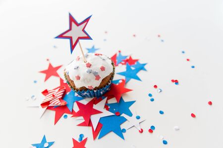 cupcake with candle and stars at 4th july party Фото со стока