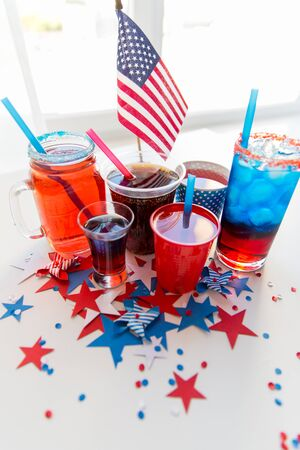 celebration, anniversary and national holidays concept - drinks in cups and glasses on table at american independence day party