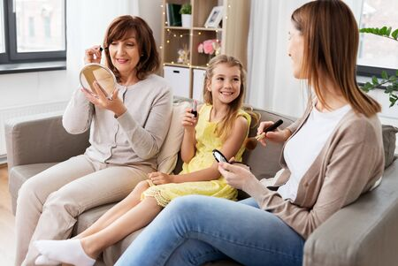 mother, daughter and grandmother doing make up