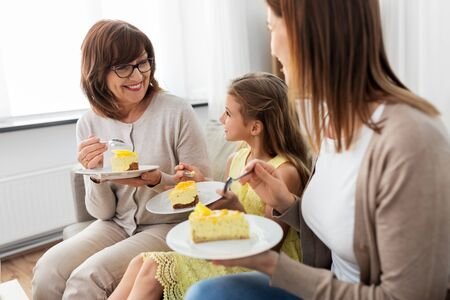 mother, daughter and grandmother eating cake