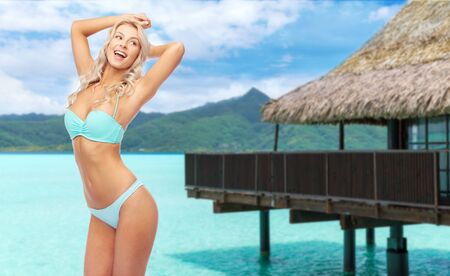 young woman posing in bikini on beach