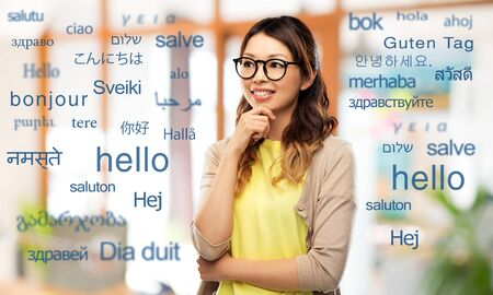 happy asian woman in glasses or student Banco de Imagens - 125091310