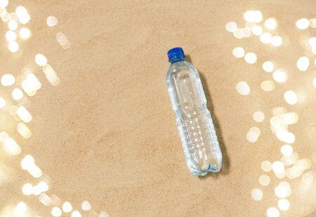 bottle of water on beach sand