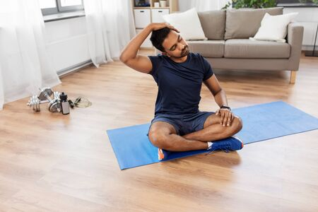 man training and stretching body at home Stock fotó