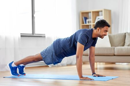 indian man doing push ups at home