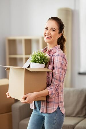 happy woman with stuff moving to new home