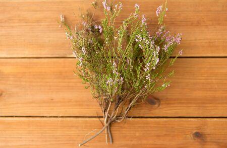 Heather bush on wooden table