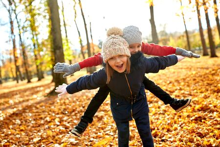 Happy children having fun at autumn park Stok Fotoğraf