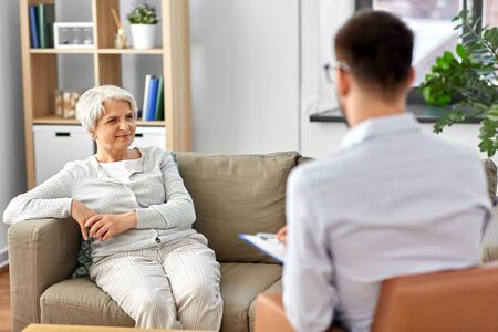 geriatric psychology, mental therapy and old age concept - senior woman patient and psychologist at psychotherapy session