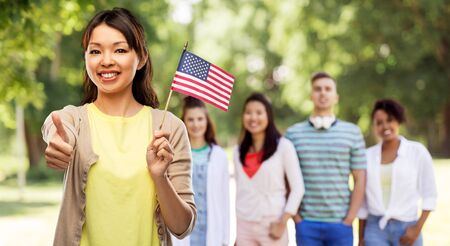 Happy Asian woman with american flag Imagens