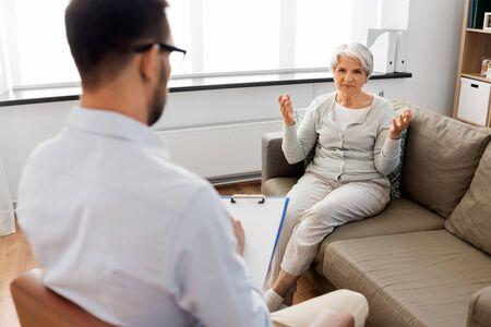 Senior woman patient talking to psychologist Stock Photo