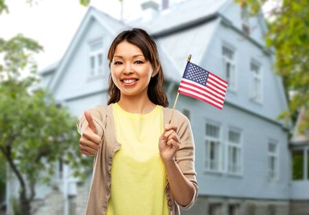 Happy Asian woman with american flag Stock Photo