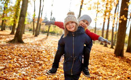 Happy children having fun at autumn park