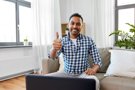 indian male blogger showing thumbs up at home Stock Photo