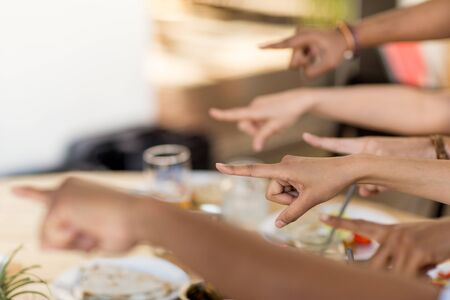 hands pointing finger to something at restaurant