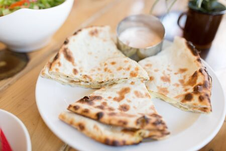 chapati bread on table of indian restaurant Stock Photo - 127344478
